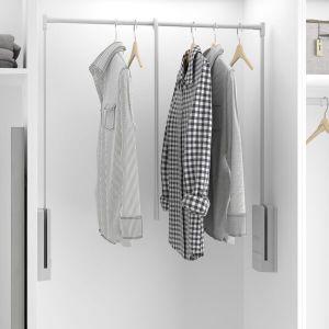Barra de colgar ropa abatible